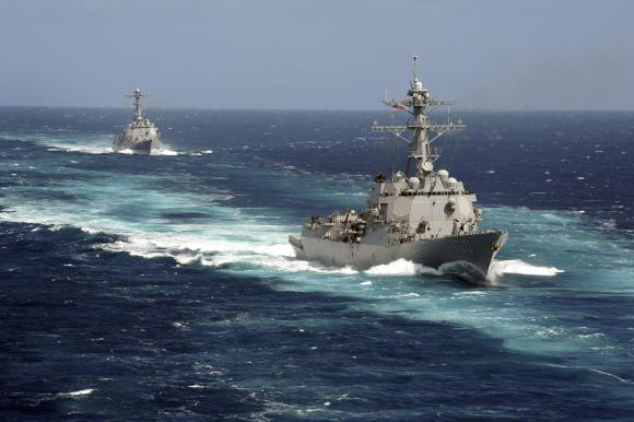 The Arleigh Burke-class guided-missile destroyers USS Kidd and USS Pinckney are seen en transit in the Pacific Ocean in this U.S. Navy picture taken May 18, 2011. Kidd and Pinkney have been searching for the missing Malaysian airliner and are being re-deployed to the Strait of Malacca of Malaysia's west coast as new search areas are opened in the Indian Ocean, according to officials on March 13, 2014.